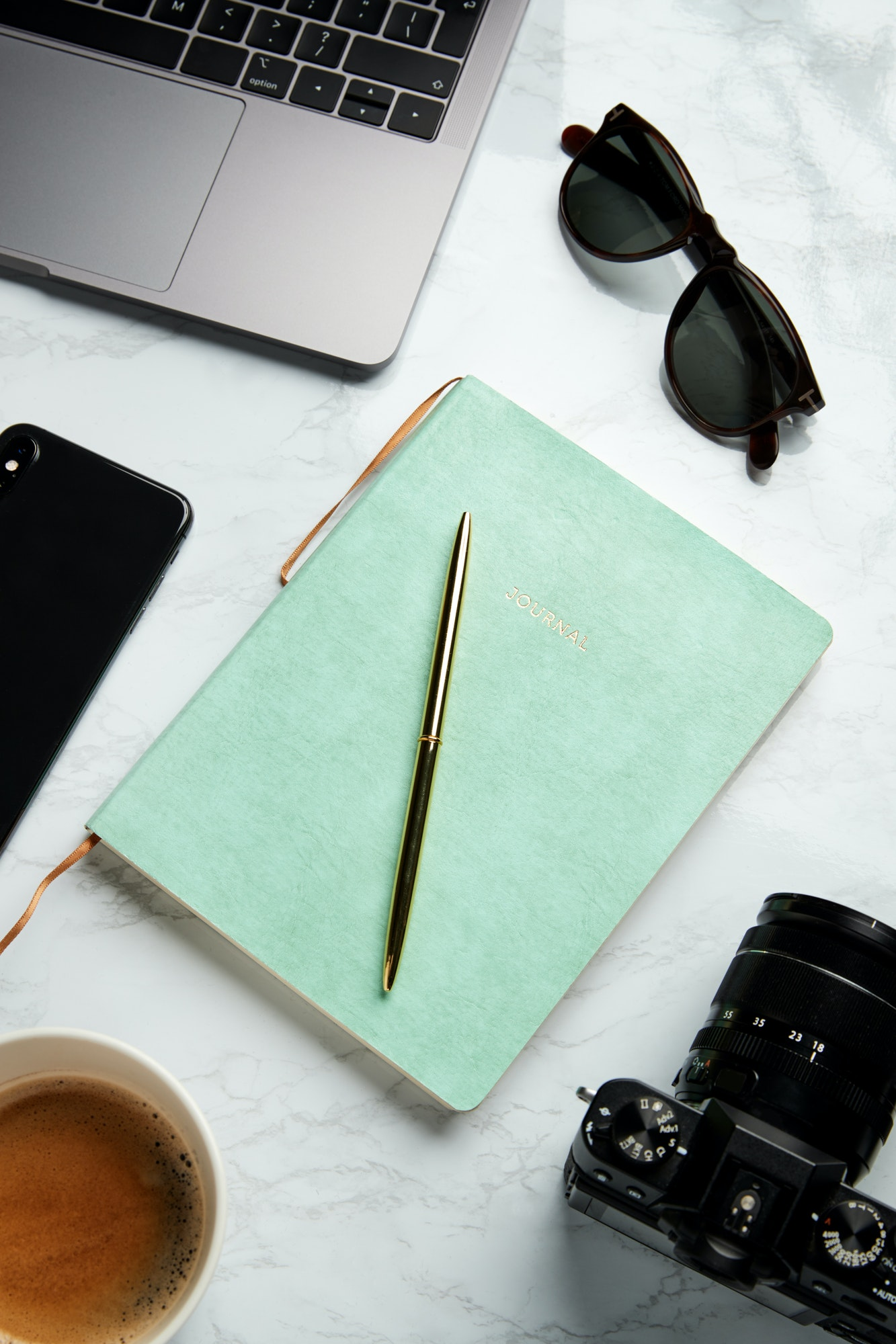 Flat Lay Shot Of Techno Items For Modern Worker With Laptop Mobile Phone Journal And Camera